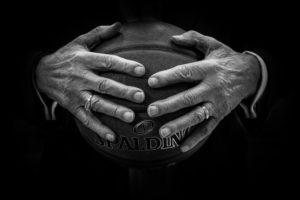 Old Hands holding basketball
